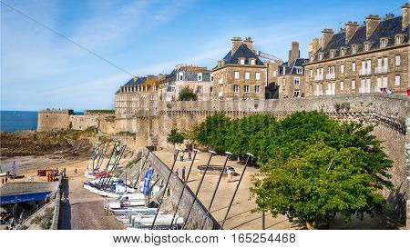 The buildings, catamarans and boats on beach Bon Secours in Saint-Malo, Bretagne, France