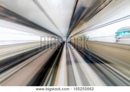 Blurred motion train moving in tunnel abstract background