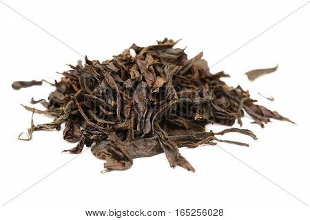 handful of dried leaves of black tea on a white background