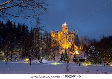 Winter view of Bran castle, also known as Dracula's castle, at blue hour