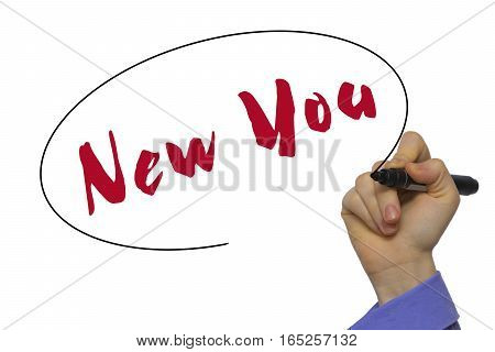 Woman Hand Writing New You On Blank Transparent Board With A Marker Isolated Over White Background.
