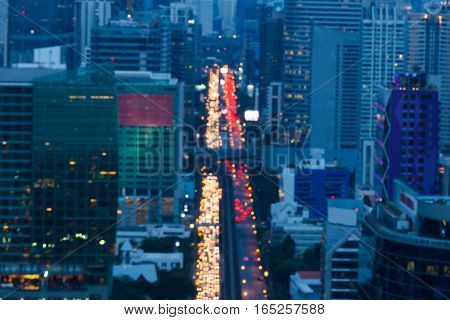 Aerial view blurred lights city road Bangkok city downtown night view abstract background