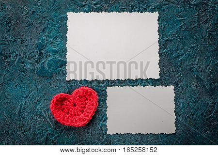 Crochet valentine hearts and greeting card on dark bacground.