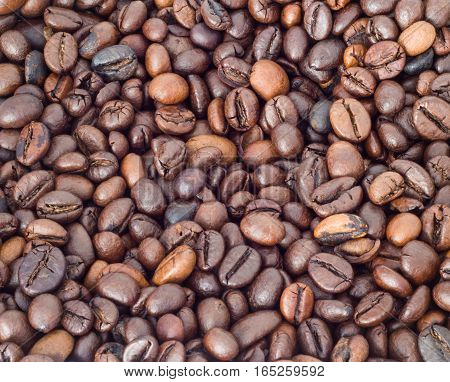 Whole roasted Coffee Beans Background close up