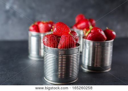 Fresh strawberry on gray background . Dessert with strawberries. Strawberries in the iron pot. Copyspace.