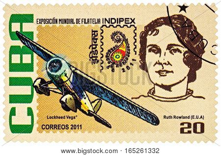 MOSCOW RUSSIA - January 14 2017: A stamp printed in Cuba shows American aviation pioneer Ruth Rowland and her airplane Lockheed Vega series