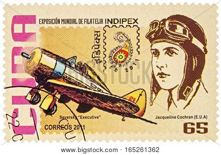 MOSCOW RUSSIA - January 15 2017: A stamp printed in Cuba shows pilot Jacqueline Cochran (USA) and her airplane Seversky