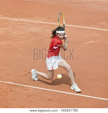 Young Tennis Player In Action