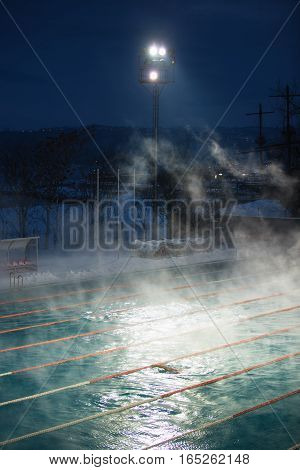 Morning Fog At Swimming Pool
