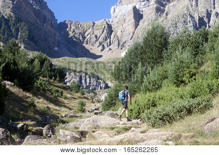 Hiker Man Going Up Of A Mountain In Pyrenees, Spain