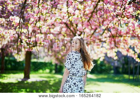 Beautiful Young Woman In Blooming Spring Park