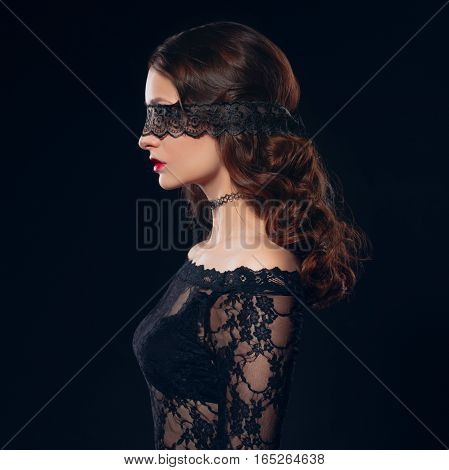 Sexy girl in black lingerie on black background. Erotic photoshoot charming attractive woman with a blindfold mask on her face. Perfect ass and beautiful makeup
