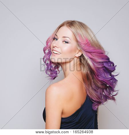 Colored hairs. Portrait of smiling women with flying hairs. Ombre. Gradient. Studio