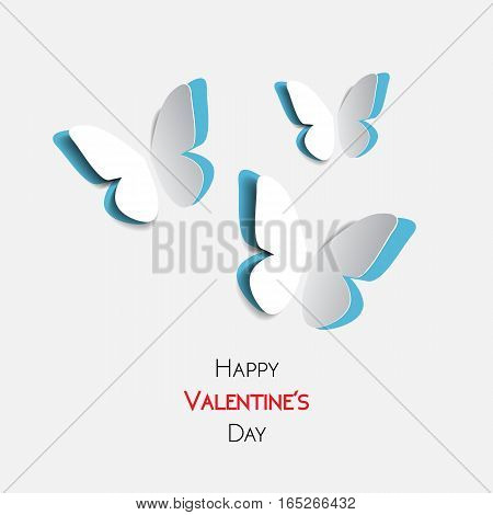 Happy Valentines Day greeting card with paper origami blue butterflies