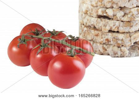 crispbread and cherry tomato on white background. healthy eating vegetarianism