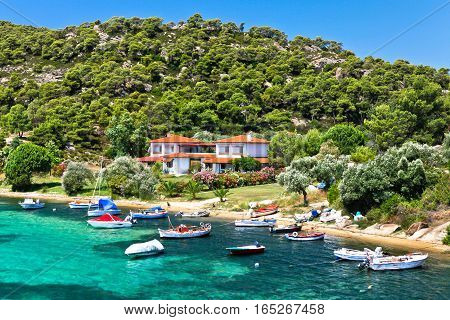 Sithonia Halkidiki Greece - July 02 2012: boats and yachts moored near the villa in a secluded location on the Aegean sea