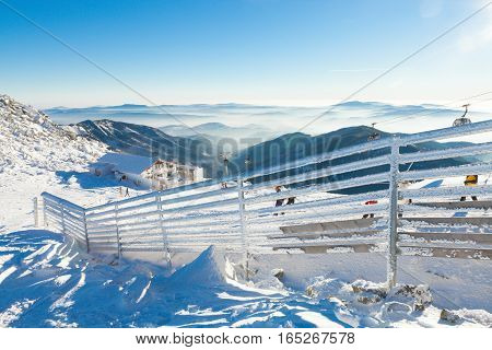CHOPOK SLOVAKIA - JANUARY 12 2017: Fence covered by heavy snow on a sunny day after a heavy blizzard at Chopok January 12 2016 in Jasna - Slovakia