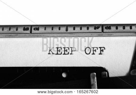 Typewriting on an old typewriter. Typing text: keep off