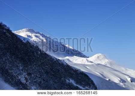 Off-piste Slope And Sunlight Blue Sky In Wind Winter Morning