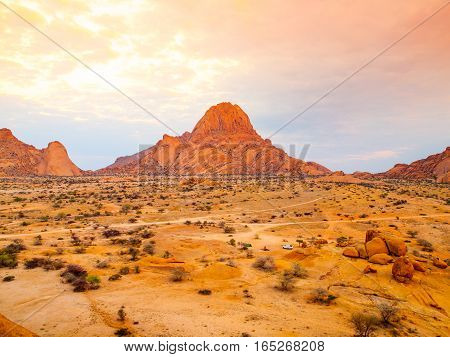 Spitzkoppe, aka Sptizkop - unique rock formation of pink granite in Damaraland landscape, Namibia, Africa.