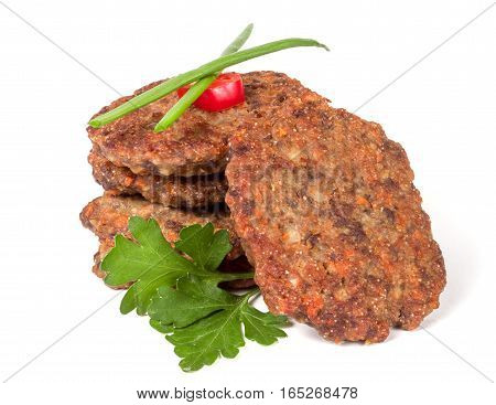 liver pancakes or cutlets with parsley and green onions isolated on white background.