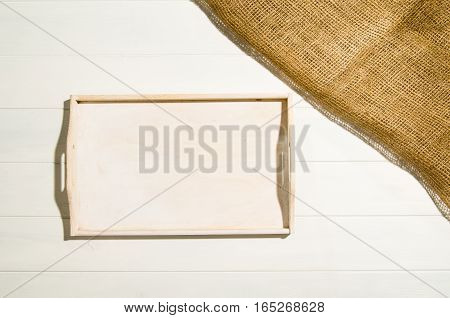 Product photo of white, painted, wooden floor with jute linen cloth. Visible texture background. Studio image taken from above, top view.