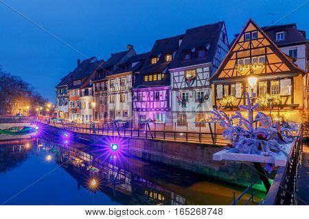 The old half-timbered houses on the canal in the blue hour. Colmar. France. Alsace.