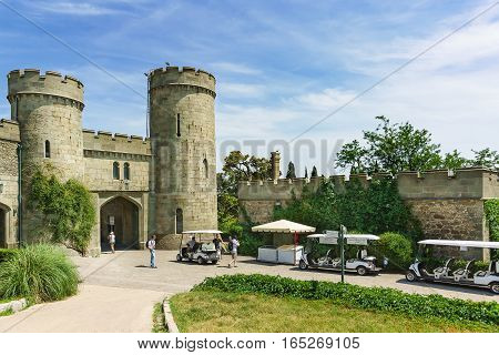 ALUPKA CRIMEA RUSSIA - JUNE 06.2016: Guided walking electric cars at the Western entrance to the Vorontsov Palace.