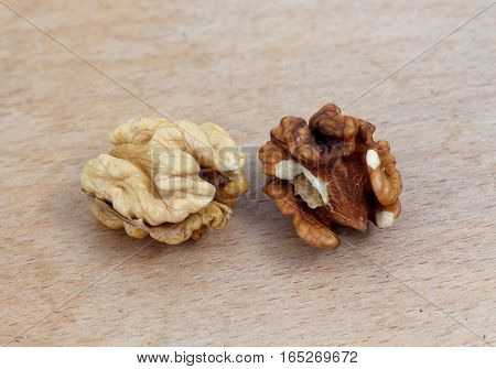 picture of a organic walnuts on a wood background