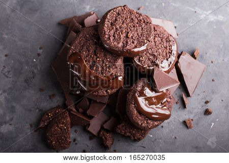 Chocolate cookies with melted chocolate and a slide of chocolate