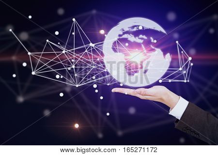 Hand holding abstract illuminated globe with connections. Global business and technologies concept