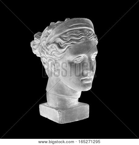 Marble head of young woman, ancient Greek goddess bust isolated on black background