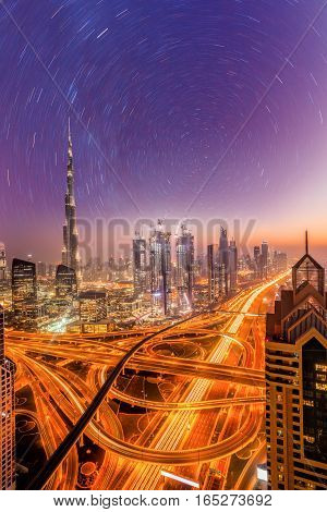 Dubai City At Night Under A Starry Sky In United Arab Emirates
