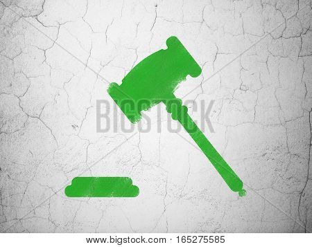 Law concept: Green Gavel on textured concrete wall background