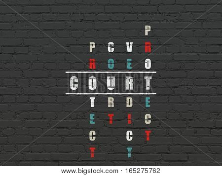 Law concept: Painted white word Court in solving Crossword Puzzle