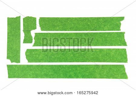 Set of used green masking tape pieces