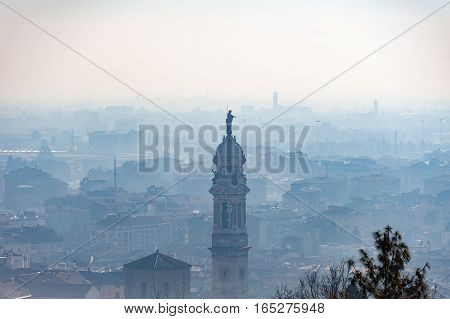 Foggy aerial view on Bergamo town, Lombardy, Italy