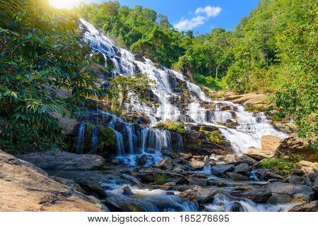 Mae Ya waterfall with green trees and blue sky backgroundat Doi Inthanon National ParkOne of the famous waterfalls of Chiang Mai.