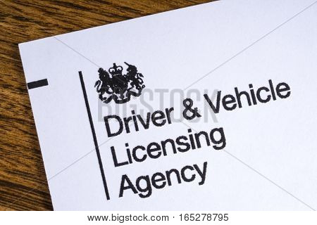 LONDON UK - JANUARY 13TH 2017: The logo for the Driving and Vehicle Licensing Agency on the corner of a leaflet on 13th January 2017.