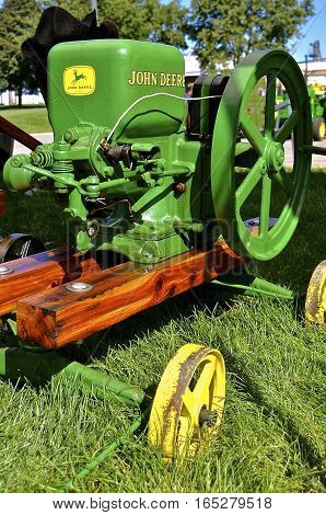 YANKTON, SOUTH DAKOTA, August 19, 2106: A restored vintage john Deere gas engine is displayed at the annual Riverboat Days celebrated the third weekend of August