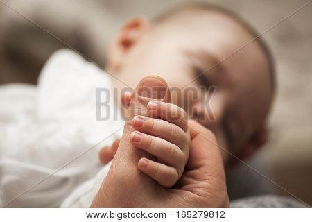 Father With His Newborn Baby Care Hands.