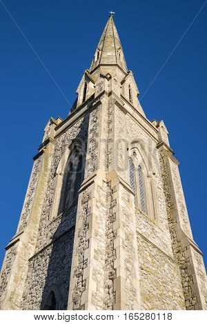 Looking up at the impressive tower of the Lion Walk United Reformed Church in Colchester Essex.