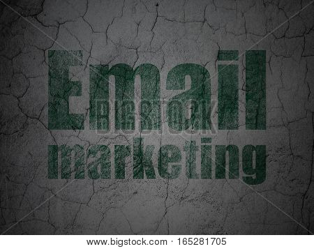 Advertising concept: Green Email Marketing on grunge textured concrete wall background