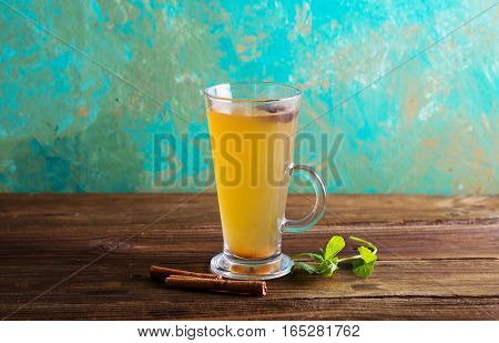 Warm cider. Grog. Mulled white wine on a green background.