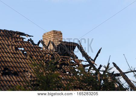 roof of the burned house on sky background