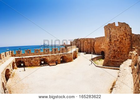The court of the Knights Grand Master Palace with Aegean sea waterscape, Rhodes Island, Greece