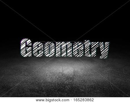 Education concept: Glowing text Geometry in grunge dark room with Dirty Floor, black background