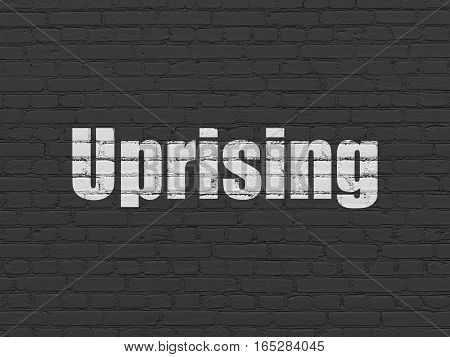 Politics concept: Painted white text Uprising on Black Brick wall background