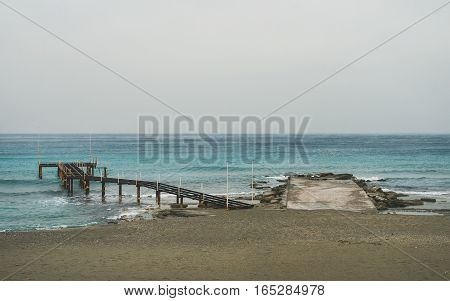 Empty sandy coast at Mediterranean sea in winter after storm in Alanya, Turkey