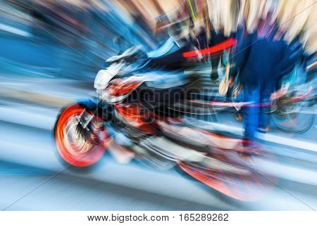 abstract blurred picture of a motorbike in city traffic